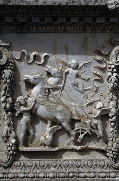 Ostia Antica. Sacellum. Altar of the Twins. Relief depicting Cupid carrying the chariot of Mars. Italy.