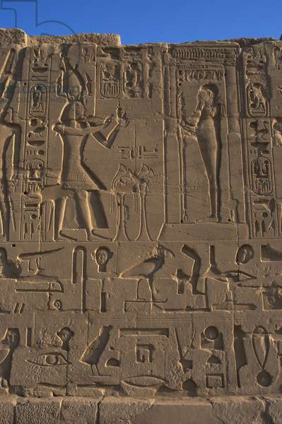 Egyptian Art. Karnak. The Pharaoh Ramesses II making an offering to the god Ptah. Relief.