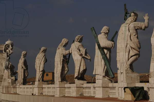 Jesus and the Apostles on the roof of St. Peter's Basilica. Vatican City.