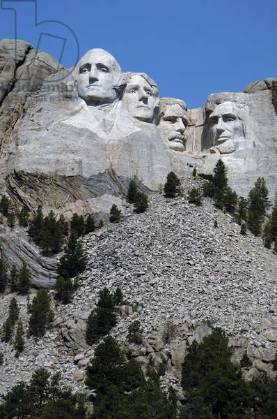 Heads of the United States's presidents carved into Mount Rushmore. From left to right, George Washington, Thomas Jefferson, Theodore Roosevelt and Abraham Lincoln. 1927-1941.