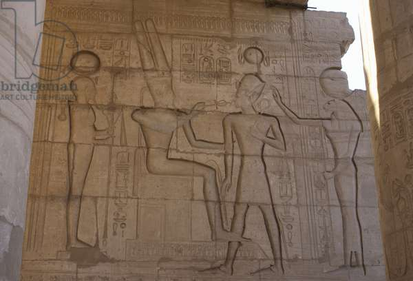 Relief depicting a Pharaoh Ramses II before gods Amun, Ptah and Tefnut. Ramesseum. Egypt.