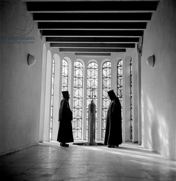 Two monks taking a quiet moment for a prayer, Glees, Germany, 1948-49 (b/w photo)