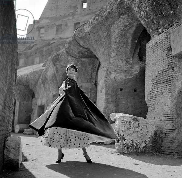 Fashion shoot of Ivy Nicholson walking in some of the ruins in Rome, 1954 (b/w photo)