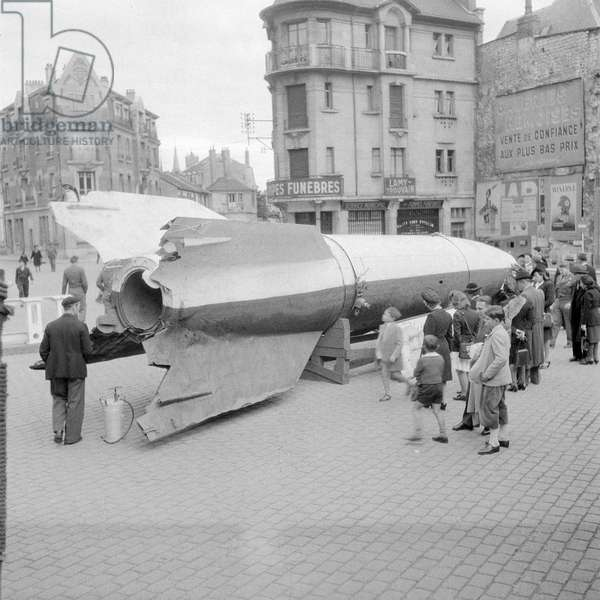 A V-2 rocket on display in Reims, France, where the German surrender was signed on May 7, 1945 (b/w photo)