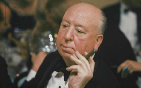 Alfred Hitchcock smoking a cigar during a Christmas party in St. Moritz, Switzerland, 1966 (photo)