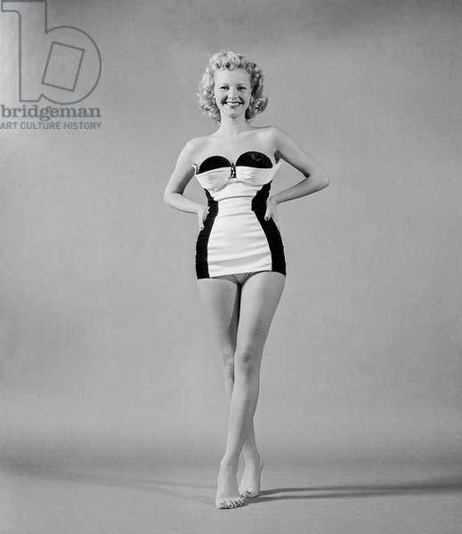 Gloria Drew modelling a swimsuit, 1951 (b/w photo)