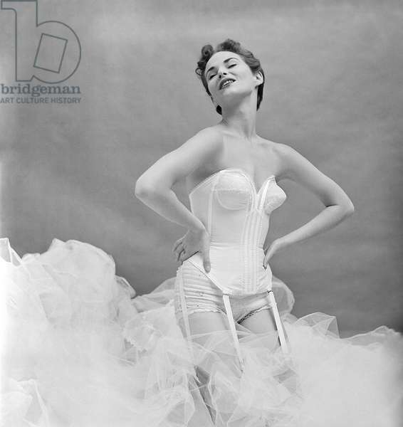 Model in a white corset, New York, c.1950s (b/w photo)