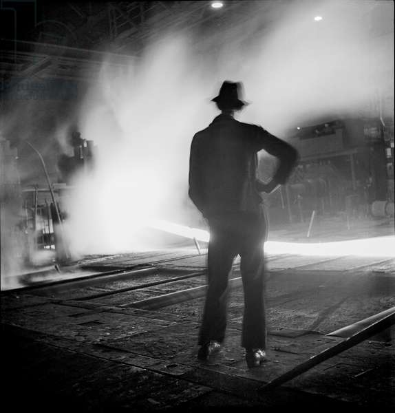 Silhouette of a factory worker in a steel factory in Saarland, Germany, 1948-49 (b/w photo)