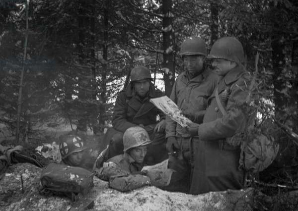 Reading Comics, Battle of the Bulge, Hurtgen Forest, Germany, 1944 (b/w photo)
