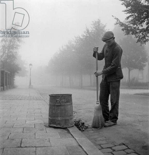 Street Sweeper, Hoshst, Germany, 1945-49 (b/w photo)