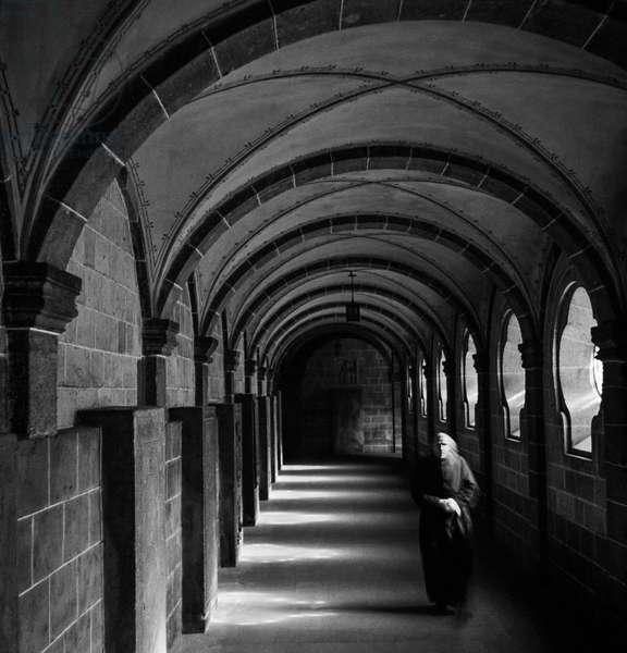 Walking the halls at Maria Laach Abbey, Glees, Germany, 1947-49 (b/w photo)