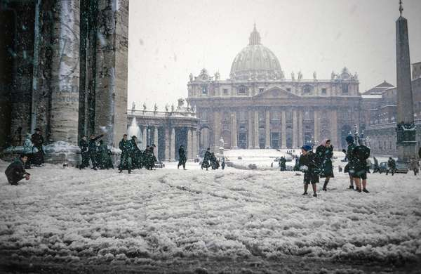 A group of young priests having a snow fight with the local kids, St Peter's Square, Rome, 1965 (photo)