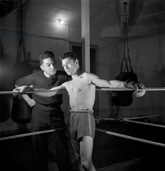 French Boxer getting instructions from his coach, 1947-49 (b/w photo)