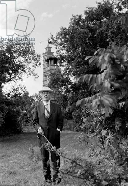Frank Lloyd Wright taking a walk around his land in Taliesin Spring Green, Wisconsin, 1957 (b/w photo)