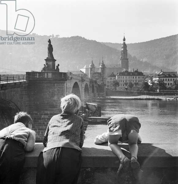 Checking out the passing boats, Heidelberg, Germany, 1948 (b/w photo)