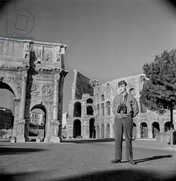 Soldier Posing in front of the Roman Colosseum, Rome, 1947 (b/w photo)