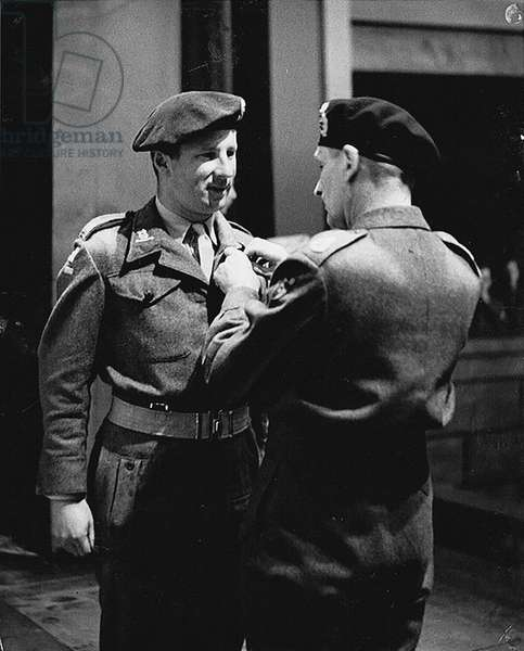 Maj. The Lord Rathdonnell receiving the MC from Field Marshall Montgomery, 12th Aug. 1945 (b/w photo)