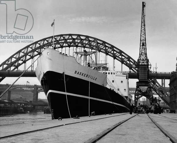The cargo ship 'Baskerville' at Newcastle Quayside, UK, c.1954 (b/w photo)