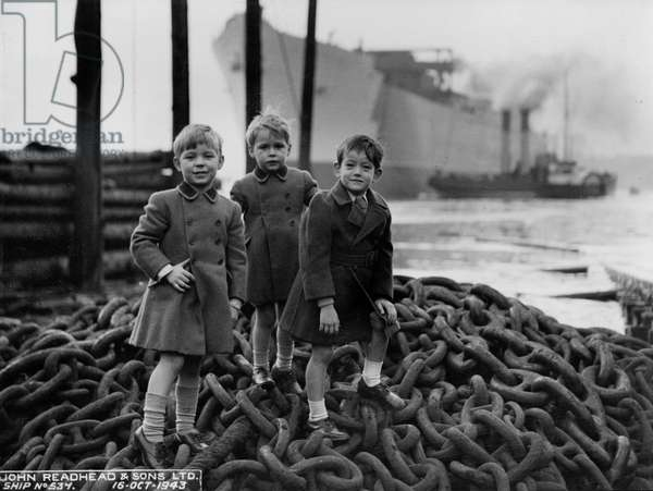 Young guests at the launch of the cargo ship 'Empire Crown', South Shields, UK, 1943 (b/w photo)