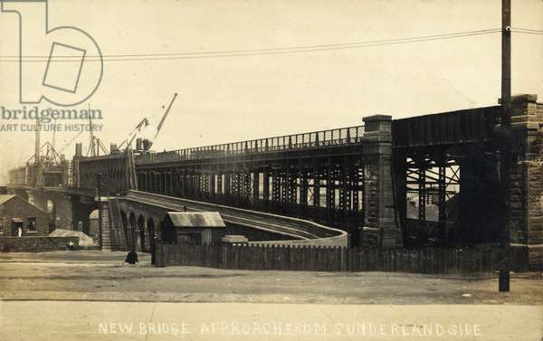 Postcard showing the latter stages of construction of the Queen Alexandra Bridge, Sunderland, UK, 1909.