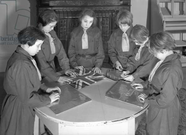 Members of the Royal Victoria School for the Blind Brownie pack taking part in craft activities, Newcastle upon Tyne, UK, Januaey 1962 (b/w photo)