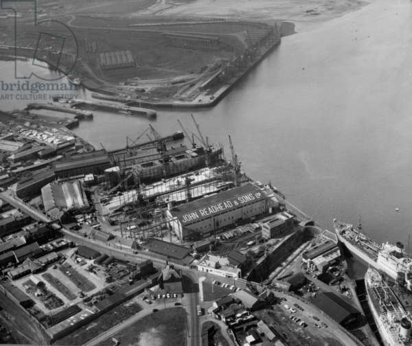 Aerial view of the shipyard of John Readhead & Sons, South Shields, UK, 1963 (b/w photo)