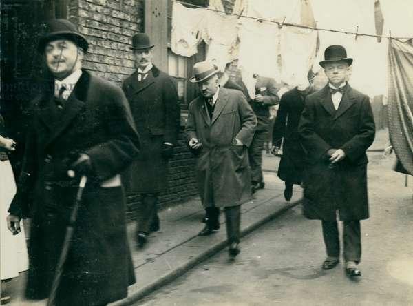 Neville Chamberlain surveying Newcastle's slums, Newcastle, UK, 1925 (b/w photo)