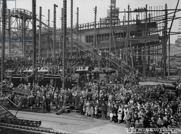Spectators and workers at the launch of the cargo ship 'Baskerville', South Shields, UK, 1946 (b/w photo)