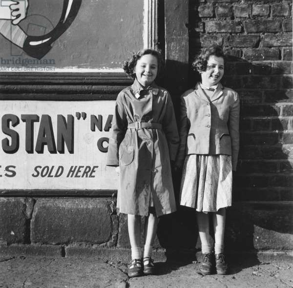 Two girls outside a shop, Sycamore Street, Newcastle upon Tyne, 1957 (b/w photo)