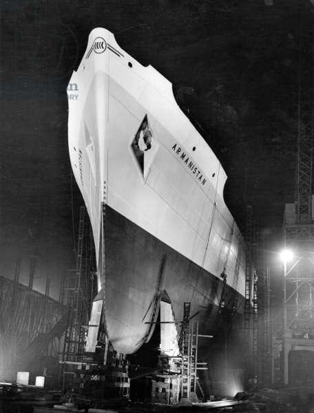 The cargo ship 'Armanistan' at night, South Shields, UK, 1948 (b/w photo)