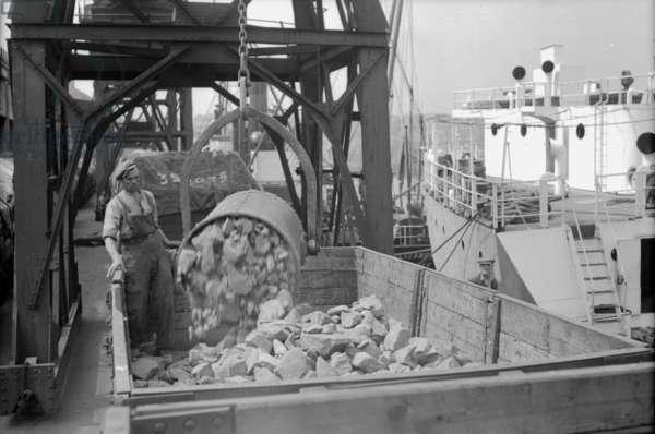 Unloading chromite into railway waggons, Sunderland, UK, 1949 (b/w photo)
