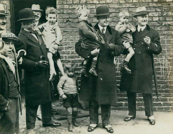 Visiting Newcastle's slums, Newcastle, UK, 1925 (b/w photo)