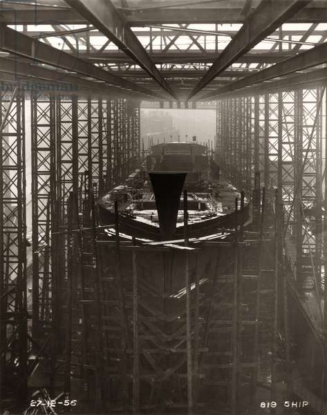 Work is ongoing around the bow of the cargo ship 'Northbank' at the shipyard of William Doxford & Sons, Sunderland, 27th December 1956 (b/w photo)