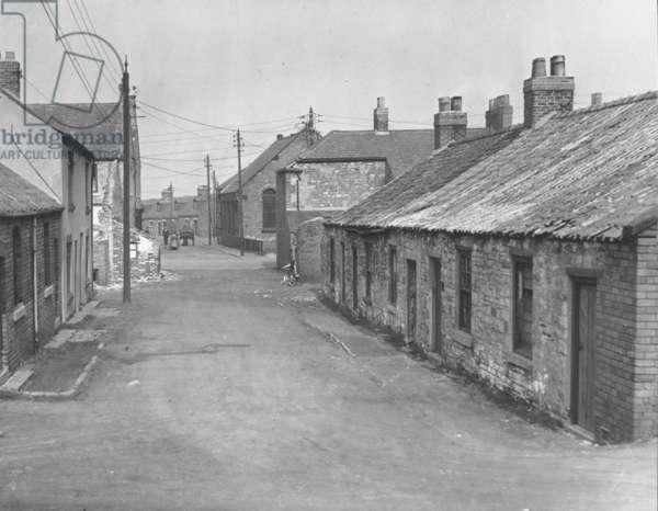 Looking along Eighth Row, Brickgarth, Easington Lane, Sunderland, UK, mid 20th century (b/w photo)