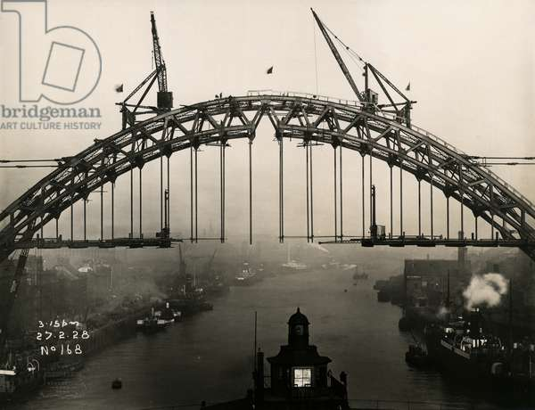 Flags fly above the Tyne Bridge to celebrate the completion of its arch, 27th February 1928 (b/w photo)
