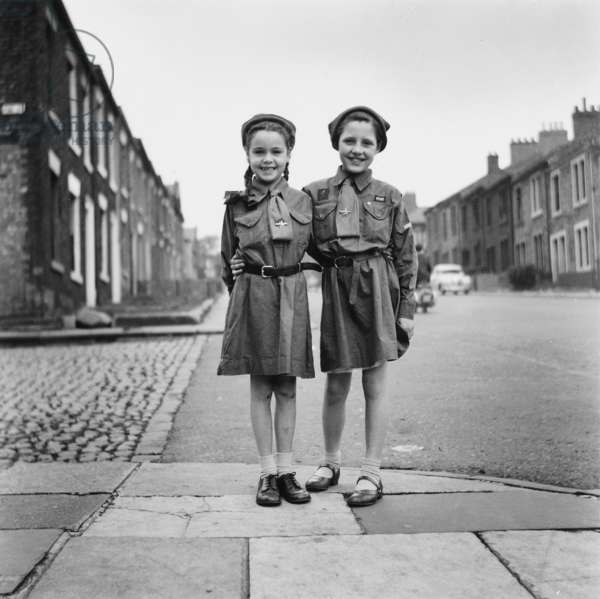 Two young Brownies standing arm in arm, 1958 (b/w photo)