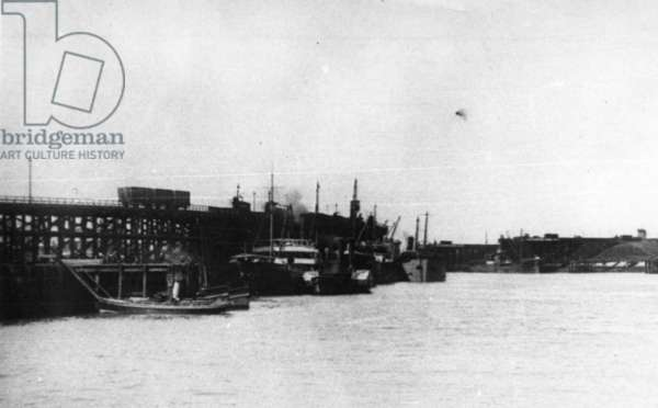 Blyth Harbour, showing an amount of colliers lying alongside Blyth Staiths with a Harbour Commission launch in the foreground (b/w photo)
