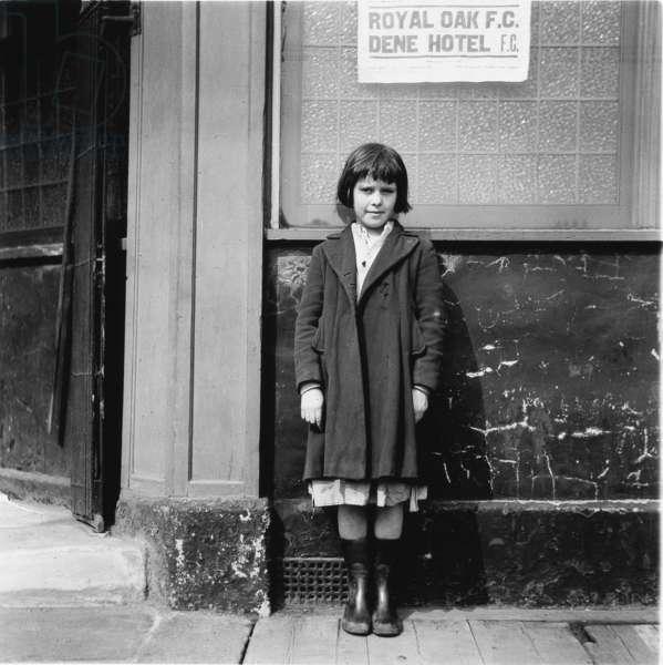 Young girl outside the Royal Oak, Scotswood, Newcastle upon Tyne, 1956 (b/w photo)