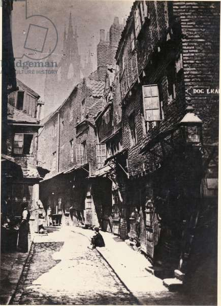 View of Castle Garth, looking towards St Nicholas Cathedral from the corner of Dog Leap stairs, Newcastle, UK, 1881 (b/w photo)