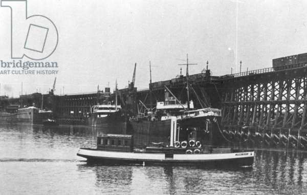 Tthe starboard side of the Blyth Harbour Commissioners launch 'John Dent' passing the staiths (b/w photo)