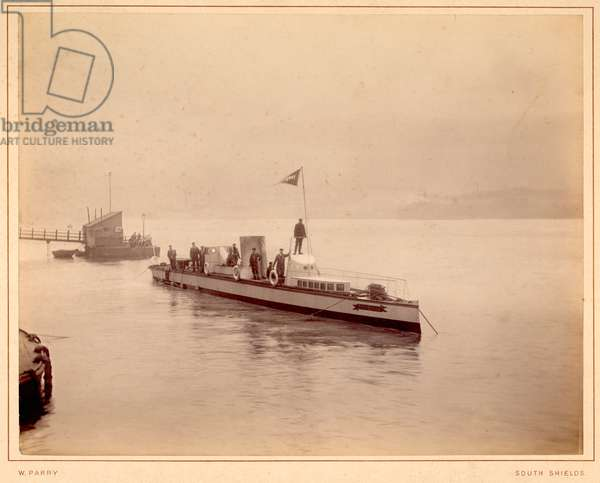 The vessel Turbinia on the river at Wallsend with crew members standing on deck (sepia photo)