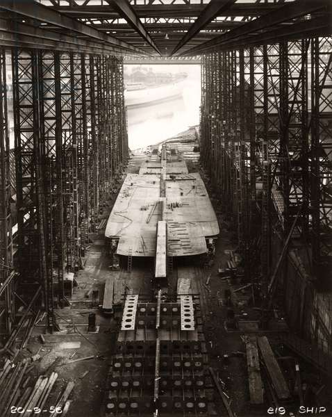 Bottom shell plating of the cargo ship 'Northbank' is put in place at the shipyard of William Doxford & Sons, Sunderland, 20th September 1956 (b/w photo)