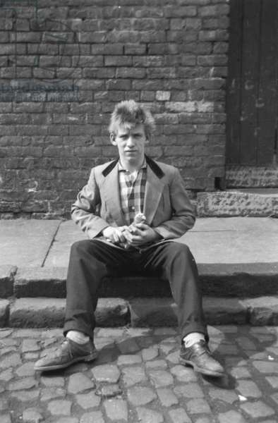 Teddy boy with homing pigeon, 1956 (b/w photo)