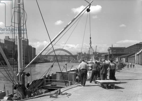 View of men working at the Quayside, Newcastle upon Tyne, UK, June 1961 (b/w photo)