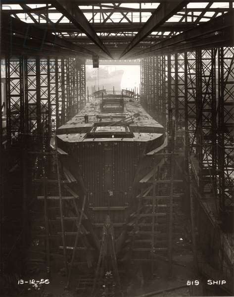 Gantry crane in operation above the cargo ship 'Northbank' at the shipyard of William Doxford & Sons, Sunderland, 13th December 1956 (b/w photo)