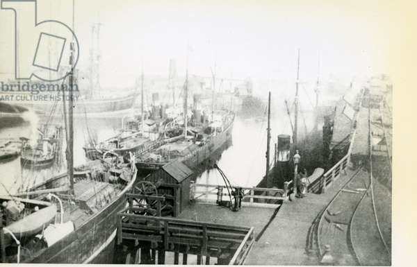 View of Blyth Harbour looking downstream with many vessels waiting to load (b/w photo)