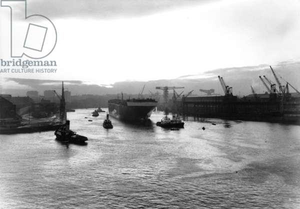 The tanker 'Daphnella' under tow on the River Wear, UK, 1965 (b/w photo)