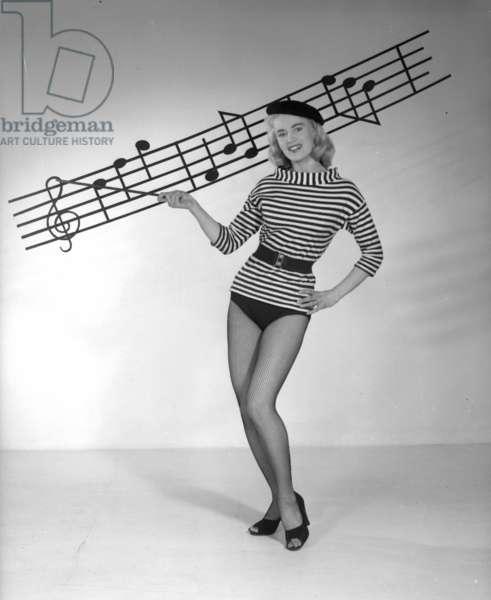 "Studio shot of the model, Rita Fisher: ""Music lessons"", 1955 (b/w photo)"