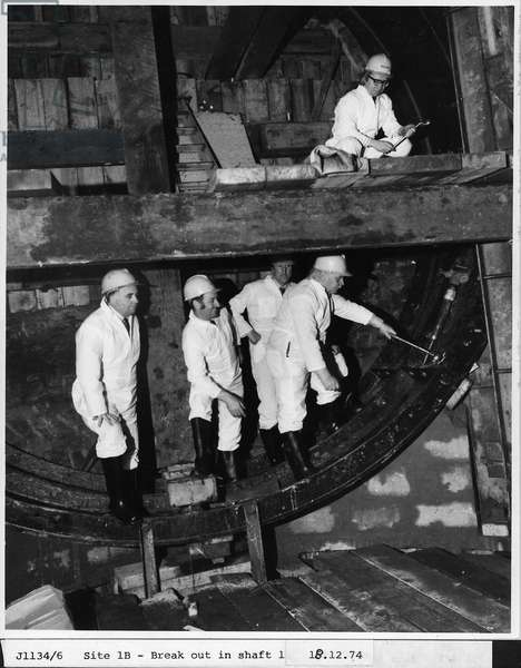 A group of men in a Metro shaft, Tyne & Wear, UK, 18th December 1974 (b/w photo)