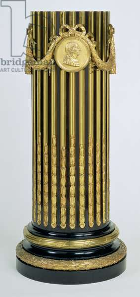 F421 Pedestal, in semi-column form, veneered on oak with ebony and brass flutes, mounted with portrait medallion of Louis II, flanked by laurel swags